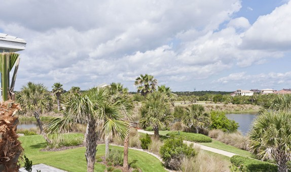 Beautiful Lake and Golf Course views from the rear 2nd floor balcony at this home in Cinnamon Beach.